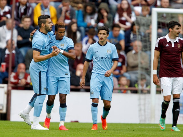 Scott Sinclair and Alvaro Negredo of Manchester City celebrate during the pre-season friendly at Tynecastle Stadium on July 18, 2014