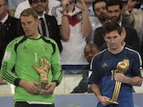 Germany's goalkeeper Manuel Neuer and Argentina's forward and captain Lionel Messi hold their respective trophies of 'Golden Glove' and 'Golden Ball' during a presentation ceremony after the final football match between Germany and Argentina for the FIFA