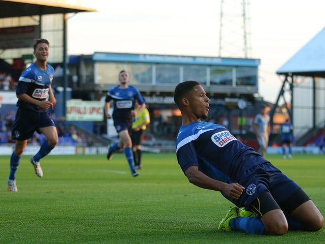 Jordan Bove of Oldham Athletic celebrates scoring against Newcastle United during the pre season friendly at SportsDirect.com Park on July 15, 2014