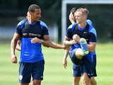 Rio Ferdinand and Jack Collison in a training session at QPR on July 18, 2014