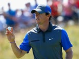 Rory McIlroy of Northern Ireland waves to the gallery during the first round of The 143rd Open Championship at Royal Liverpool on July 17, 2014