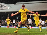 Sheffield United's English striker Shaun Miller and team mates celebrate scoring the only goal in the English FA Cup fourth round replay football match between Fulham and Sheffield United at Craven Cottage in London on February 4, 2014