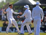 South Africa cricketer Dale Steyn celebrates with teammates after he dismissed Sri Lankan batsman Lahiru Thirimanne during the third day of the opening Test match between Sri Lanka and South Africa at the Galle International Cricket Stadium in Galle on Ju
