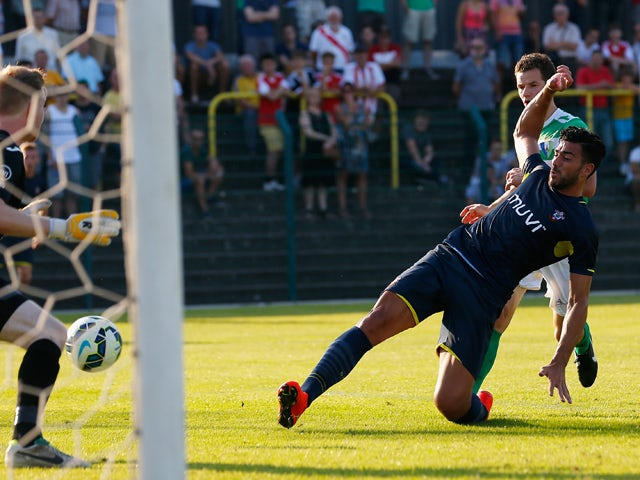 Graziano Pelle of Southampton scores his second goal during the pre-season friendly match between KSK Hasselt and Southampton at the Stedelijk Sportstadion on July 17, 2014
