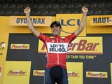 Stage winner France's Tony Gallopin celebrates on the podium after winning the 187.5 km eleventh stage of the 101st edition of the Tour de France cycling race on July 16, 201