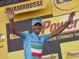 Stage winner Italy's Vincenzo Nibali celebrates on the podium after winning the 197.5 km thirteenth stage of the 101st edition of the Tour de France cycling race on July 18, 201