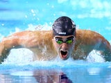 England's Adam Barrett during the heats for the 100m butterfly on July 27, 2014