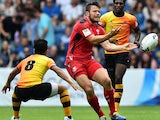 Wales's Adam Thomas passes the ball on July 26, 2014