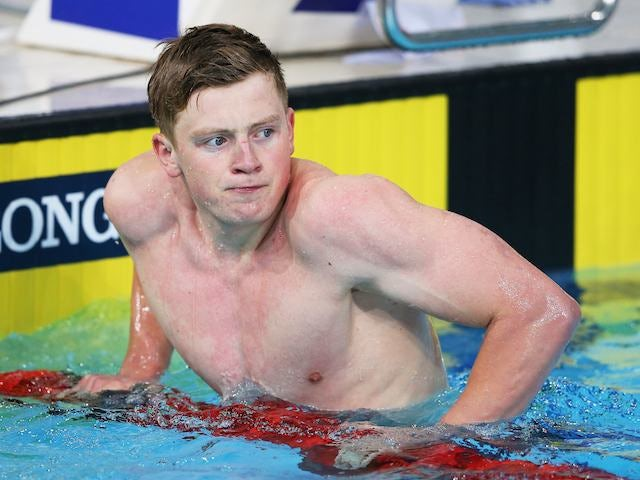 England's Adam Peaty after setting a new Games record during the 100m breaststroke heat on July 25, 2014