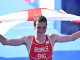 England's Alistair Brownlee celebrates winning the gold in the men's triathlon