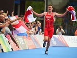 England's Alistair Brownlee runs towards the finish line to claim gold in the mixed relay on July 26, 2014
