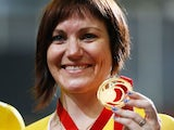 New Zealand's Anna Meares showing off her gold medal on July 24, 2014