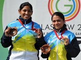 Gold medalist Apurvi Chandela and Silver medalist Ayonika Paul both of India pose for pictures with their medals following the Women's 10m Air Rifle at the Barry Buddon Shooting Centre in Carnoustie, Scotland, on July 26, 2014