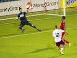 Andreas Weimann #10 of Aston Villa scores a goal against Raul Fernandez #1of FC Dallas during an international friendly on July 23, 2014