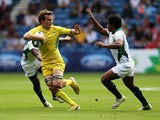 Con Foley of Australia is tackled by Sudharshana Muthutantri of Sri Lanka in the Rugby Sevens match between Australia and Sri Lanka at Ibrox Stadium during day three of the Glasgow 2014 Commonwealth Games on July 26, 2014