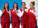 Becki Turner, Amy Smith, Francesca Halsall and Siobhan O'Connor of England pose with their silver medals during the medal ceremony for the Women's 4 x 100m Freestyle Relay Final at Tollcross International Swimming Centre during day one of the Glasgow 2014