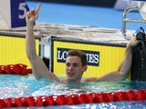 Ben Proud celebrates winning gold in the 50m butterfly on July 25, 2014