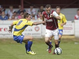 Dean Marney of Burnley competes with Josh Windass of Accrington during the pre-season friendly between Accrington Stanley and Burnley at the Store First Stadium on July 27, 2014