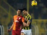Fenerbahce's Mehmet Topal fights for the ball with Galatasaray's Ceyhun Gulselam (L) during the Turkish Super League football match between Fenerbahce and Galatasaray, at Sukru Saracoglu stadium in Istanbul, on November 10, 2013