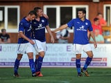 Chris Wood (C) of Leicester City celebrates with team-mate Andy King (L) after he scored the second goal of the game for his side during the pre season friendly on July 22, 2014