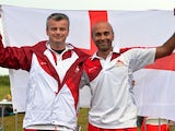 England's gold medalists David Luckman and Parag Patel celebrate winning the Queens Prize Pairs at Barry Buddon Shooting Centre during the 2014 Commonwealth Games in Carnoustie, Scotland on July 26, 2014