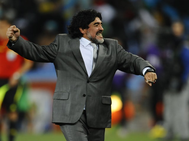 Argentina's coach Diego Maradona celebrates after Argentina's striker Carlos Tevez scored a third goal for his team during the 2010 World Cup round of 16 match Argentina vs Mexico on June 27, 2010