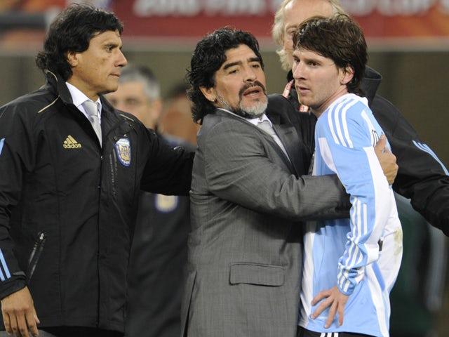 Argentina's coach Diego Maradona hugs Argentina's striker Lionel Messi after the 2010 World Cup quarter final Argentina vs Germany on July 3, 2010
