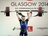 Cyprus's gold medalist Dimitris Minasidis competes in the men's weightlifting 62kg class at the 2014 Commonwealth Games in Glasgow, Scotland, 25th July 2014