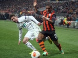 Czech defender Milan Petrzela of FC Viktoria Plzen vies for the ball with Brazilian forward Douglas Costa of FC Shakhtar Donetsk during the round of 32 UEFA Europa League football match Shakhtar Donetsk vs Plzen on February 27, 2014