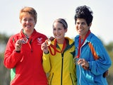 Wales's silver medalist Elena Allen (L), Australia's gold medalist Laura Coles (C) and and Cyprus's bronze medalist Andri Eleftheriou ® on July 25, 2014