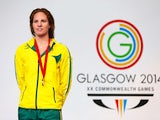 Gold medallist Emily Seebohm of Australia poses during the medal ceremony for the Women's 100m Backstroke Final at Tollcross International Swimming Centre during day three of the Glasgow 2014 Commonwealth Games on July 26, 2014