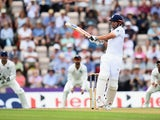 Alastair Cook of England smashes the ball towards the boundary during Day 1 of the 3rd Investec Test match between England and India at the Ageas Bowl on July 27, 2014
