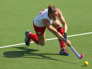 Kate Richardson-Walsh of England passes during the Women's preliminary match between England and Wales at Glasgow National Hockey Centre during day one of the Glasgow 2014 Commonwealth Games on July 24, 2014