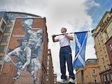 Euan Burton, multiple World and European medal winning judoka poses with the Scottish Saltire flag on September 21, 2014