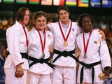 Bronze medalists Faith Pitman and Katie Jemima Yeats-Brown of England, Gold medalist Sarah Clark of Scotland and Silver medalist Helene Wezeu Dombeu on July 25, 2014