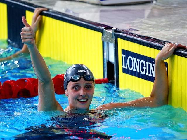 England's Francesca Halsall gives the thumbs-up after setting a new Games record in the semi-final of the women's 50m freestyle on July 25, 2014