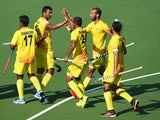 The Indian hockey team celebrate after demolishing Wales on july 25, 2014