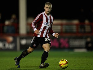 Jake Bidwell of Brentford in action during the Sky Bet League One match between Brentford and Crewe Alexandra at Griffin Park on November 16, 2013