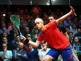 James Willstrop of England in action against Peter Barker of England during the semi-finals of the Canary Wharf Squash Classic on March 27, 2014