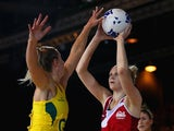 England's Joanne Harten and Australia keeper Laura Geitz battle for the ball on July 26, 2014