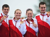 England's gold-winning mixed relay triathlon team Jodie Stimpson, Vicky Holland, Alistair Brownlee and Jonathan Brownlee on July 26, 2014