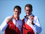 Brothers Alistair and Jonathan Brownlee with their gold and silver triathlon medals on July 24, 2014