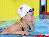 Katerine Savard of Canada reacts after winning the gold medal in the Women's 100m Butterfly Final at Tollcross International Swimming Centre on July 25, 2014