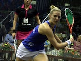 Laura Massaro of England plays a shot against Nour El Sherbini of Egypt during the Final of the CIMB Women's World Championships at the Spice Arena on March 23, 2014