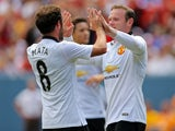 Wayne Rooney #10 of Manchester United celebrates his second goal with Juan Mata #8 during the first half of an International Champions Cup match against AS Roma at Sports Authority Field at Mile High on July 26, 2014