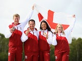 Men's Double Trap medalists Matthew French and Steven Scott pose with Women's Double Trap medalists Charlotte Kerwood and Rachel Parish at Barry Buddon Shooting Centre during day four of the Glasgow 2014 Commonwealth Games on July 27, 2014