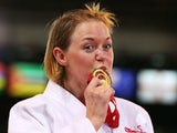 Gold medalist Megan Fletcher of England poses on the podium during the medal ceremony for the Women's -70kg Judo at SECC Precinct on July 24, 2014