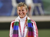 England's Natalie Melmore poses with her gold medal during the women's lawn bowls singles awards ceremony during the Commonwealth Games in New Delhi on October 13, 2010