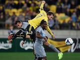 Newcastle United's Steven Taylor and Rolando Aarons jump for the ball with Phoenix's Jeremy Brockie during the Phoenix and Newcastle United football match at the Westpac Stadium in Wellington on July 26, 2014