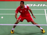 Rajiv Ouseph of England plays a return to Jan O Jorgensen of Denmark during their Thomas Cup badminton match at Siri Fort Stadium in New Delhi on May 20, 2014